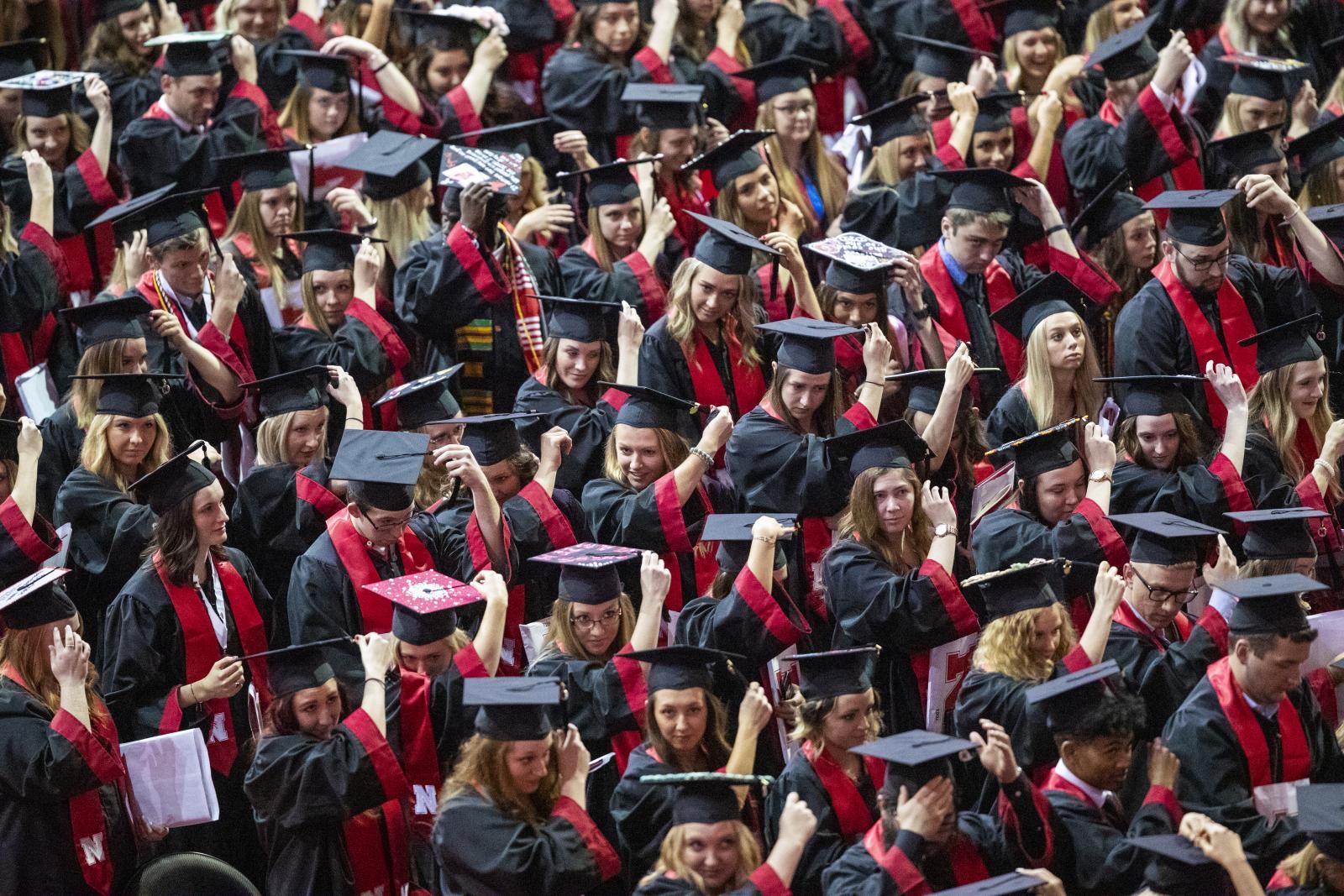 Nebraska graduates turn their tassels at commencement.