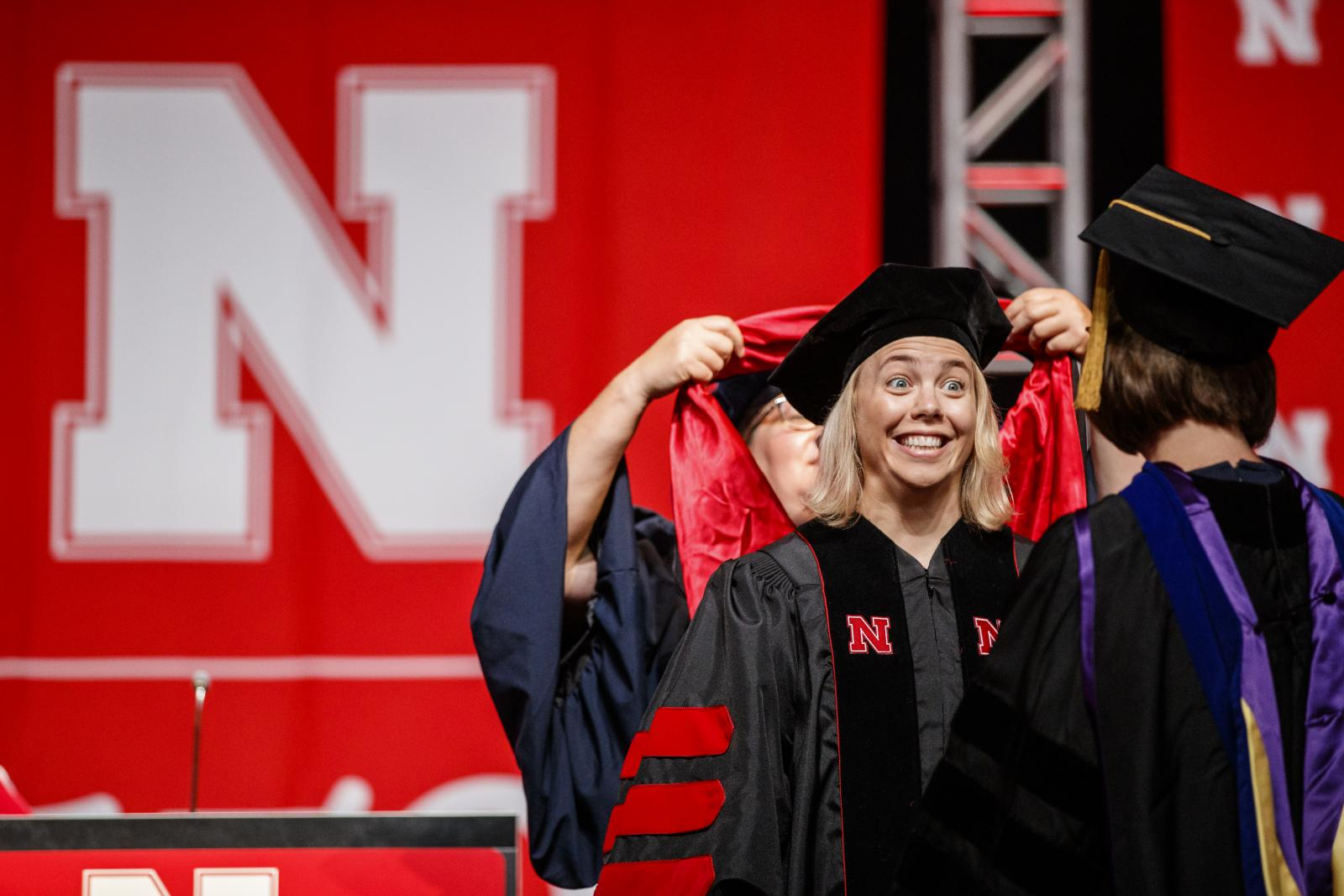Nebraska graduate receives her doctoral hood.