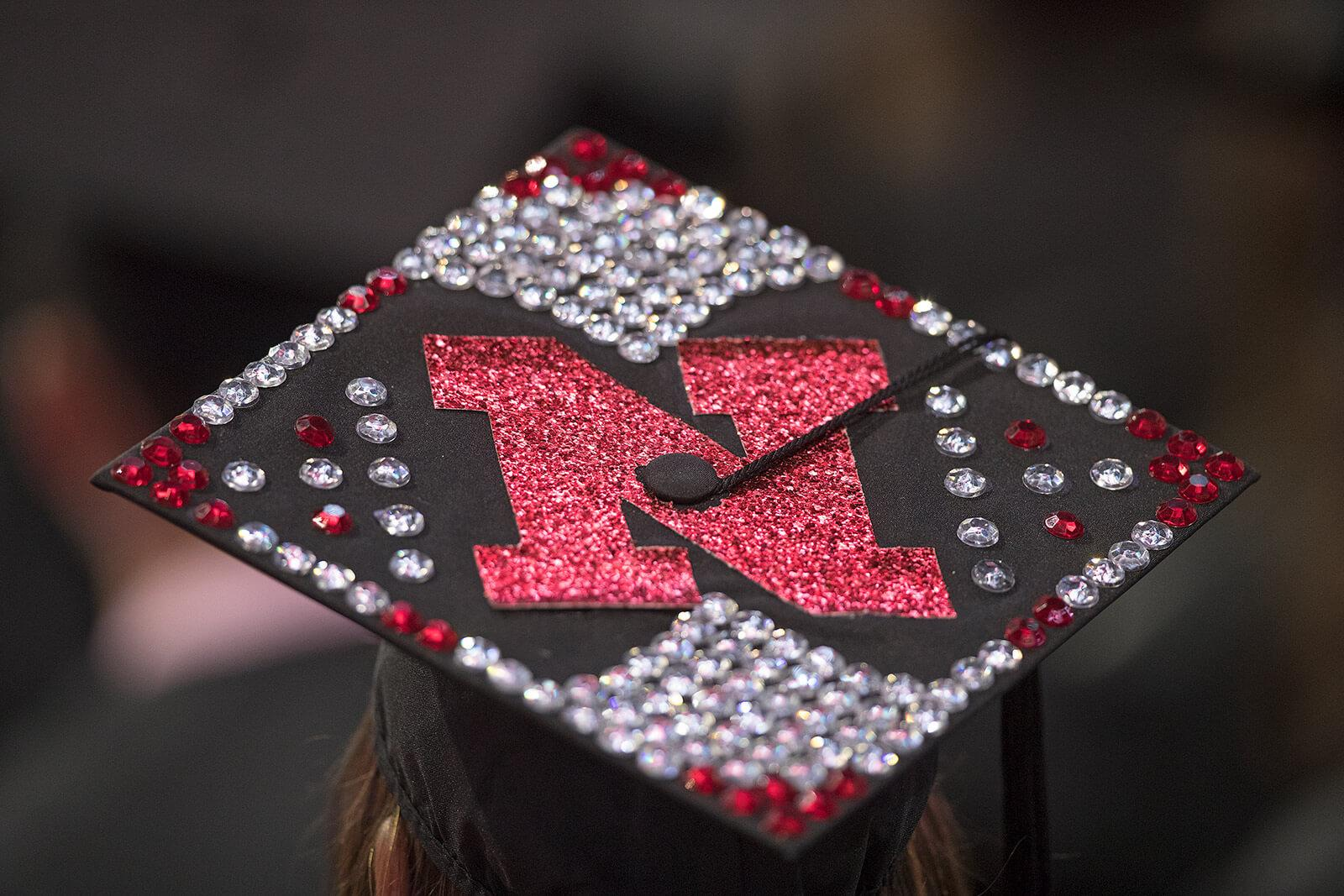 Mortar board decorated with N and jewels