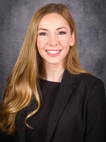 Student portrait in front of gray backdrop