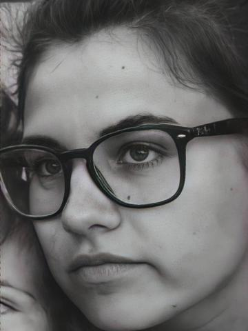 Black and white portrait of student with glasses