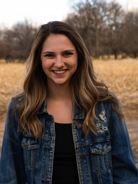Student portrait outside in field